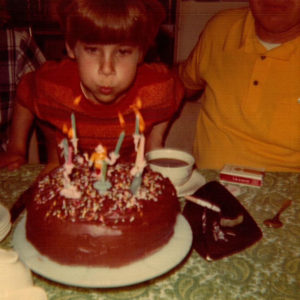 Bill Gillespie is seen here blowing out birthday candles in this 1972 family photo.